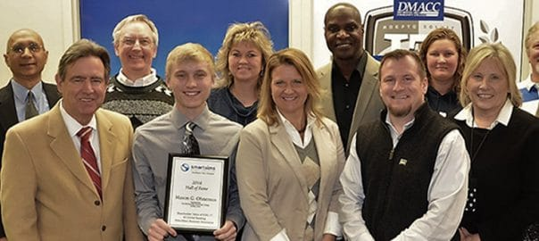 Mason (MikesBikes Student) received award from DMACC President