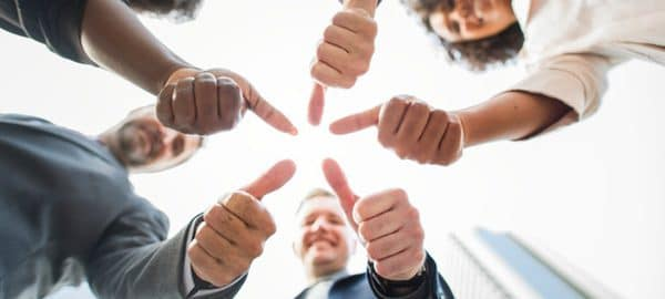 group of people with thumbs up - business simulations are where mistakes are encouraged